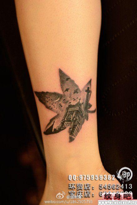 腿部树叶与教堂纹身图片